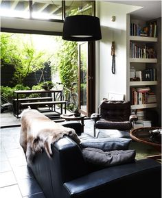 justthedesign:Tiled Floor/Leather Sofa/Open to Outside