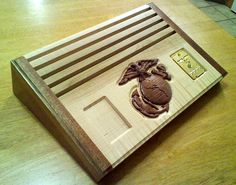 The carving of the Marine Corps Eagle, Globe and Anchor is protected by the United States Marine Corps Trademark Office; Saw Dust By Design License Challenge Coin Holder, Challenge Coin Display, Cnc Projects, Projects To Try, Military Crafts, Military Challenge Coins, Military Memorabilia, Marines, Usmc