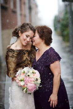 sweet moment between the mother of the bride and her daughter.