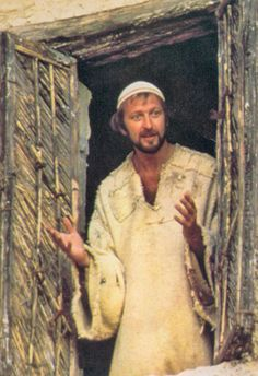 Graham Chapman - Life of Brian   1979. There's the great scene when Brian has awakened, is scratching himself and he goes to the window.