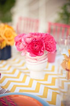 Bright flowers on chevron tablecloth