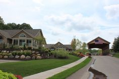 The Villas of Ada covered bridge - By Covenant Developments - Summer Landscaping (Community Built by Covenant Developments)