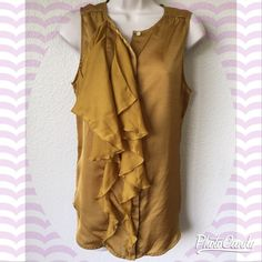 Gorgeous gold ruffled blouse! Classy and sophisticated top by Gap! Gold button-down top with sheer ruffles.. Transitions perfectly from work to dinner☺️ Size small, great condition! GAP Tops Blouses