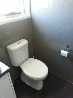 Owners have the same wall tile to floors, gives the feel the room is much bigger now Renting A House, Wall Tiles, Playground, Kitchen Remodel, Toilet, Renovated Kitchen, Kitchen Cabinets, Flooring, Bathroom