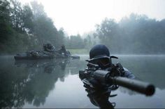 Kayak Fishing Bass Special operations forces combat diver transits the water armed with an assault rifle Wall Art, Canvas Prints, Framed Prints, Wall Peels