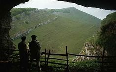 Shepherds look at the view from a cave in the Pyrenees of French Basque Country, south of St Jean-Pied-de-Port