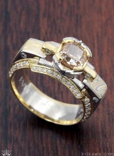Mokume Falling Water Engagement Ring. Customized here in platinum, 18k yellow gold, Summer Mokume Gane and a 1.12ct champagne diamond center stone with white diamond accents.