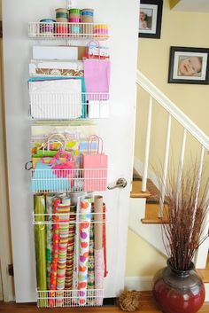 Gift bag and wrapping organization - on the inside of the coat closet door... I just did this in our guest room closet and it is so convenient- bought everything at container store Elfa sale