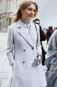 Natalia Vodianova in a muted overcoat and jewel-collar top