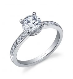 This 18K white gold diamond engagement ring features a 1-carat round brilliant cut center diamond. A total of 0.16 carats of round brilliant diamonds graduate down the sides.