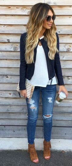 Distressed jeans, white tunic, navy jacket with gladiators