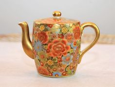 """Japanese Satsuma Pottery Teapot, Signed Bizan C. 1900- Height 4 3/4"""" x Length 6 1/2"""" : This teapot has a beautiful floral motif with gold highlights, gold handle, spout and finial, signed underneath Bizan under Shimizu Mon."""