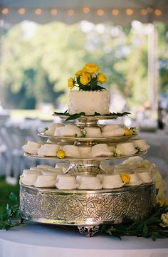 White wedding cake and cupcakes