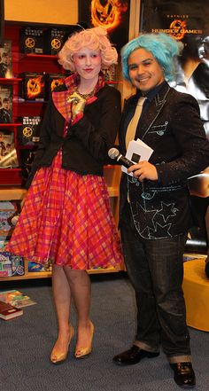 <3 them:  Effie Trinket and Caesar Flickerman make an appearance at The Hunger Games party in The Scholastic Store. Halloween costume idea, anyone? (Photo Credit: Nadia Almahdi)