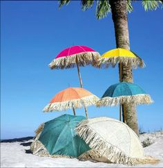 Country Originals beach umbrellas trimmed with raffia fringe. So cute.