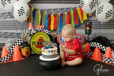 race car themed cake smash birthday party photo, formula one, cones, red suit, balloons, celebrate, driver, theme, themed, little boy, sprinkles, little man, passion, cars, racing, GilmoreStudios.com