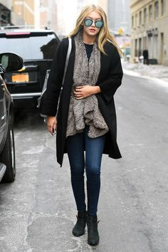 Gigi looked so fall chic in jeans, an oversized sweater, scarf, and sunglasses.