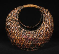 Elegant moon or crescent shaped ikebana basket is from Japan. | Made of split bamboo,