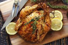 Simple and delicious roasted whole chicken recipe with an either butter or ghee herb mix. Choose an organic, free-range chicken for the best nutrition, moistness and flavor. Easy paleo and gluten free recipe.