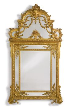 A RÉGENCE STYLE CARVED GILTWOOD AND COMPOSITION MIRROR<br>France, late 19th century | lot | Sotheby's
