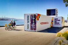 New Zealand on Screen is a new project to showcase Kiwi film, TV and music videos right on shipping containers! The organization wanted to engage visitors using dynamic facilities that could enliven quiet spaces around the country, so with help from New Zealand based Storybox, they retrofitted the containers and a caravan and turned them into interactive media rooms.