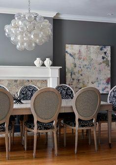 Dark Modern Dining Design With Statement Hanging Light Fixture