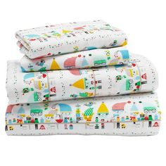 """There's an old saying that goes, """"If you want something done right, have it done by your elf."""" At least, we think that's how it goes. Either way, the illustrated characters on our exclusive elf sheets were most certainly done right. Designed just for us by artist Suzy Ultman, the super soft cotton flannel bedding is available for a crib, toddler bedding or big kid bed.<br /><br /><NEWTAG/><ul><li>Nod exclusive</li><li>A Suzy Ultman Design</li><li>Made from super soft cotton…"""