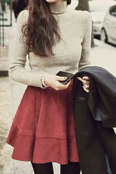 neutral turtleneck with a cranberry skater skirt and tights.