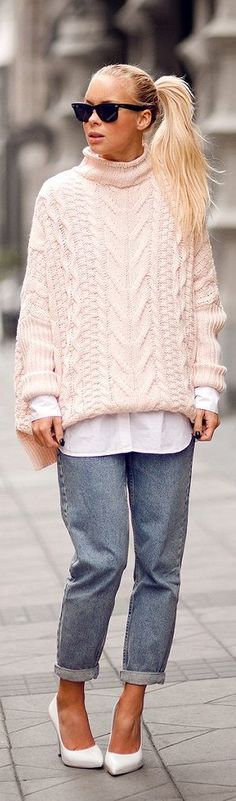 Pale pink oversized cable knit and relaxed fit jeans. Style and comfort.