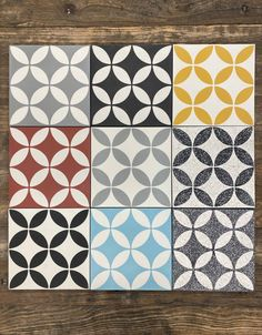 The Circulos pattern is a cement tile classic. Changing the color can give you a myriad of different looks to match the mood of a space. We can also make the tiles in a Terrazzo finish to add to your options. Most tiles pictured are in stock. Tile Patterns, Terrazzo, Cement, Chevron, Toilet, Fabrics, Layout, Rainbow, Mood