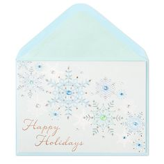 Pale blue and white snowflakes accented with foiling and gems are featured on this elegant holiday card.