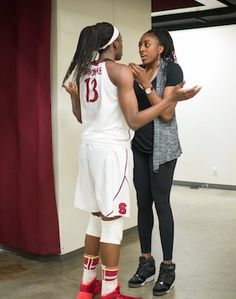 Big sis Nneka Ogwumike talks to sister Chiney Ogwumike at half time during the elite eight in 2014. Stanford was down but pulled out the win, assist to Nneka!!