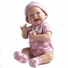 """JC Toys 15"""" La Newborn Pink Polka Dot Onesie by JC Toys. $49.99. La Newborn is a 15"""" all vinyl anatomically correct """"Real Girl"""". Comes in a polka dot onesie and hat. Perfect for all children 2 and above. From the Manufacturer                Come play with me. Our La Newborns have amazingly realistic and beautiful expressions. Dressed in beautiful and soft pink polka dot outfit, she is a joy to hold and love. 15"""" All Vinyl Anatomically Correct """"Real Girl"""" Doll. Perfect for ..."""