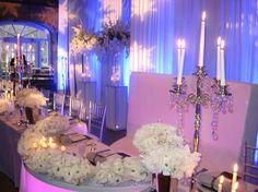 Close up of Sweetheart Table.  The Bride and Groom have the best seat in the house!  A White Suede High Back Sofa with a white acrylic light-up table!