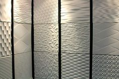 textured tiles by Interlam. Looks like Richard Castle Apartment wall treatment!We really loved the Kohler booth; it was probably our favorite booth (and not just because they had a phone charging station!Wall textures made of charcoal or fabric board Textured Wall Panels, Mdf Wall Panels, 3d Panels, 3d Wall Tiles, Tile Art, Decorative Wall Tiles, Cement Tiles, Mosaic Tiles, 3d Wanddekor