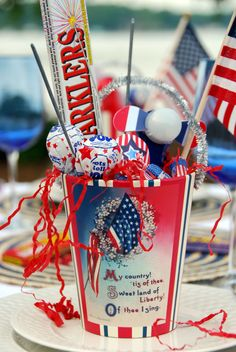 A trip to Dollar Tree kept me from liberating all of the cash from my wallet~ where I filled my pails with Red, White, & Blue goodies. . . including a battery operated Fan, Patriotic Tootsie Roll Midgees & Pops, mini Flags and Sparklers.
