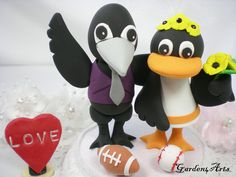 Custom Sports Team Mascot Wedding Cake Topper - NFL Baltimore Ravens &  MLB Oriole Love Couple with Beautiful Stand. $89.00, via Etsy.
