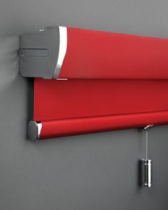 Senses Red Roller Blind with Chrome accessories  http://www.facebook.com/pages/ZODIAC-INTERIORS-BLINDMAKERS/206646331101