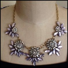 HOST PICKPretty Statement Necklace This necklace has a gold chain with lobster claw closure. There is a combination of rhinestones with the other stones in a soft gray. Unknown Jewelry Necklaces