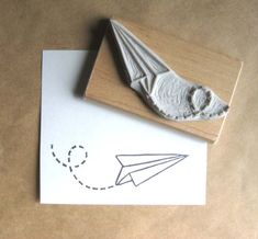 Paper Plane Air Mail Hand Carved Stamp. $12,00, via Etsy.