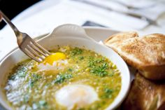 Green shakshuka—a baked egg dish popular in the Middle East and North Africa. Chef Julia Jaksic blends green tomatoes, birdseye chilies, garlic and cumin, then pours the smooth salsa over two jumbo eggs. The platter is served with slices of toasted challah bread, the perfect vehicle for scooping up every last bit of this rich, piquant stew.