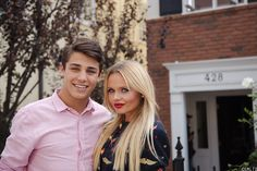 Tanner Zagarino and Alli Simpson take time between scenes to pose for a picture.