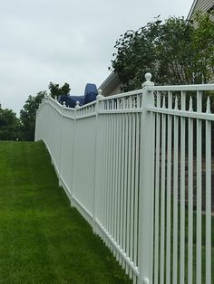 White ornamental aluminum fence, three rail with alternating spear top