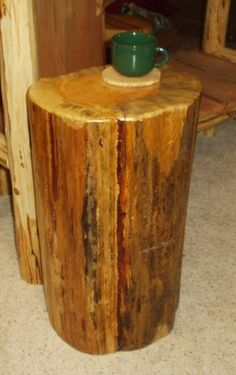 log end table - seal with polyurethane.  Living room?  Front porch?  Back patio?