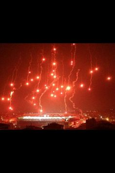 Fenerbahçe Şükrü Saraçoğlu Stadyumu,İstanbul - fenerbahce fans throw fireworks from plane with parachute   during match against bate borisov played without spectators.