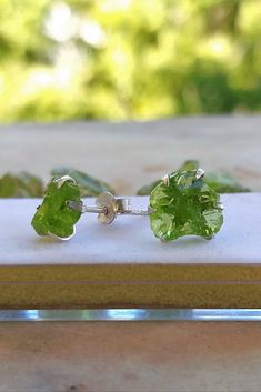 Add happiness to your day with our absolutely eye catching natural raw Peridot sterling silver studs earrings with push back closure .  It's dainty and can be worn daily . High quality materials and attention to detail . rock the day effortlessly .All our jewels are stamped with hallmark 925, indicating the purity of the silver .Hypoallergenic   Beautifully design to shine and capture attention  Unique Earrings, Beautiful Earrings, Stud Earrings, Unique Jewelry, Handmade Gifts For Her, Sterling Silver Earrings Studs, Stone Jewelry, Stones And Crystals, Decoration