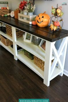 Easily make this wood console table in a weekend. This rustic console table can be made for under $50 by a beginner with little woodworking skills. The x design is optional, so don't feel intimidated to try this wood DIY project! #diywoodprojects #consoletable #rusticconsole #diyconsoletable