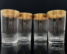 Set of 2 vintage lead crystal longdrink glasses with gold rim. Very high quality lead crystal, the rim is hard gold-plated.  Manufactured by THERESIENTHAL in West Germany  This is a classical series from 1950-60s. Typically for this period, it combines elegance with function. Each glass is decorated with rich textured gold rim.  In very good vintage condition - absolutely no damages. Please take a moment to analyze the pictures for more details.  Each glass is 105 mm (4.13) high. Diameter at…