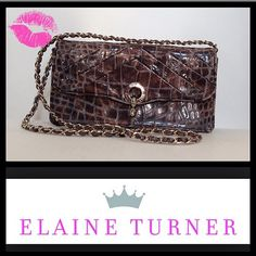 """Elaine Turner Crossbody An exquisite and timeless Elaine Turner Crossbody Python print with detachable chain strap,Gold hardware, several pocket organizers located inside. Size 10""""wide x 5""""tall. If one is not familiar with designer Elaine Turner you should google, her handbags are GORGEOUS! Bought at Neiman Marcus. Same day & next day shipping!  PayPal TradesHolds Elaine Turner Bags Crossbody Bags"""