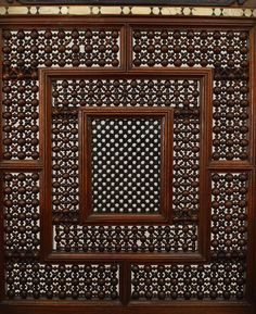 Middle Eastern Moorish style arm chair with carved spindle & ball design back with pearl & bone inlay and ebonized trim